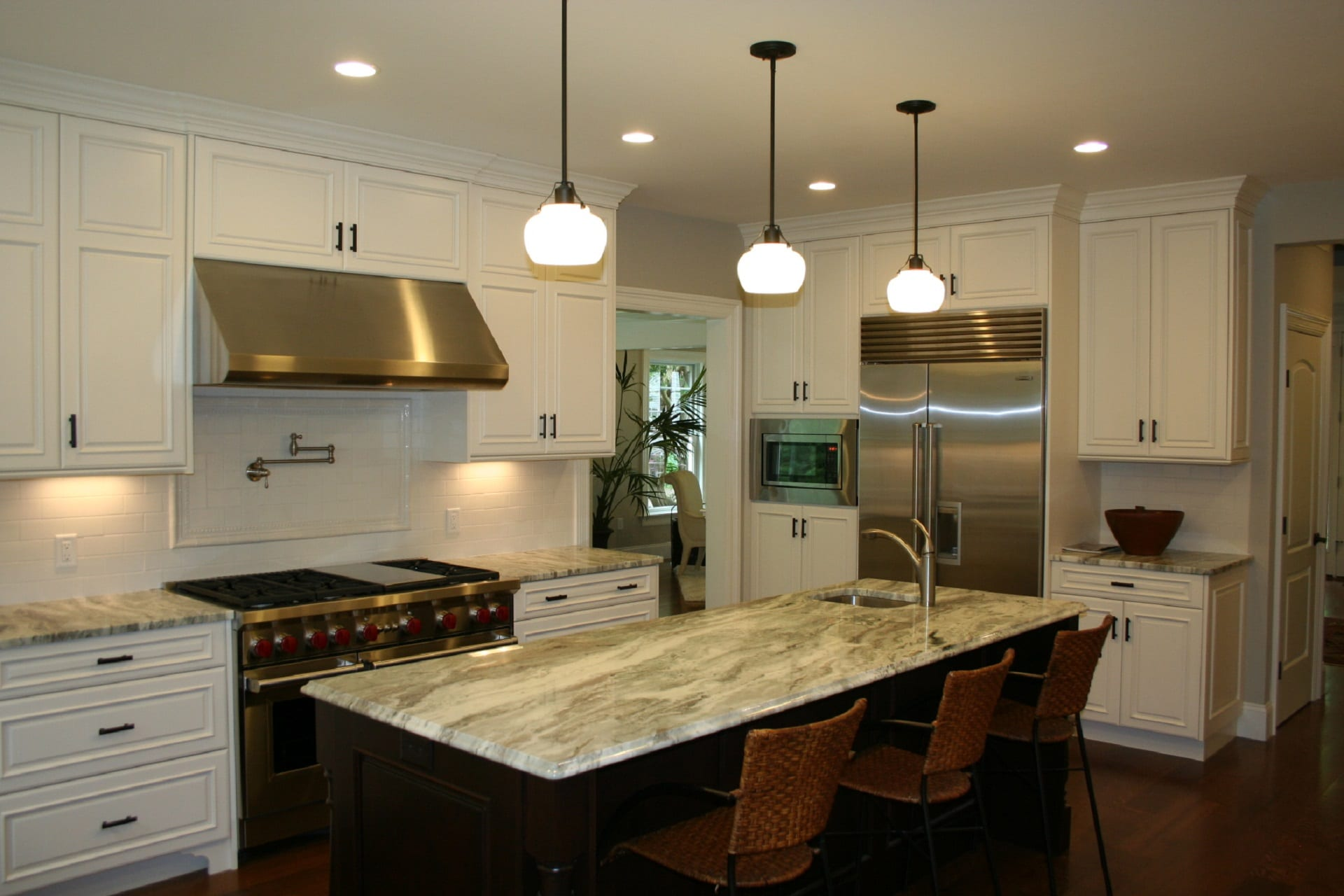 White Kitchen with Walnut Island