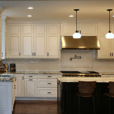 White Stacked Kitchen Cabinets and Dark Island