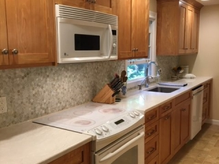 Natural red birch kitchen cabinets with clear finish