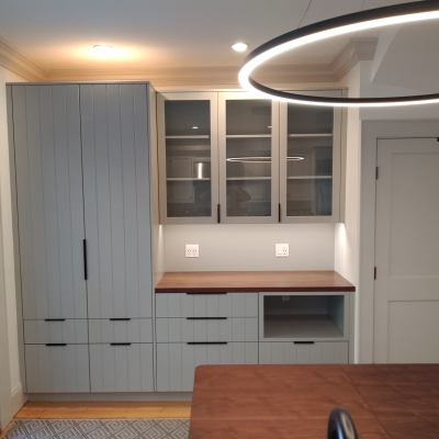 Pantry with gray slab doors and walnut counter
