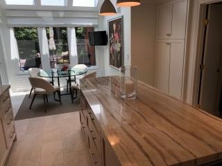 White kitchen cabinets with quarterzone white oak island