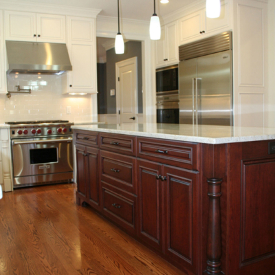 White cabinets and cherry island