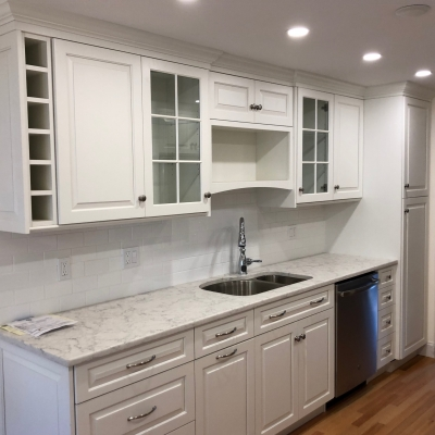Traditional style, white kitchen cabinets, raised panels, wine cubby, glass doors