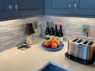 Grey Kitchen cabinets with Top Knobs Trunk Pulls and Clear Octagon Crystal Knob