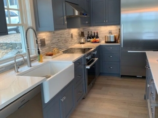 Ipswich, MA Grey Kitchen cabinets with farmers sink